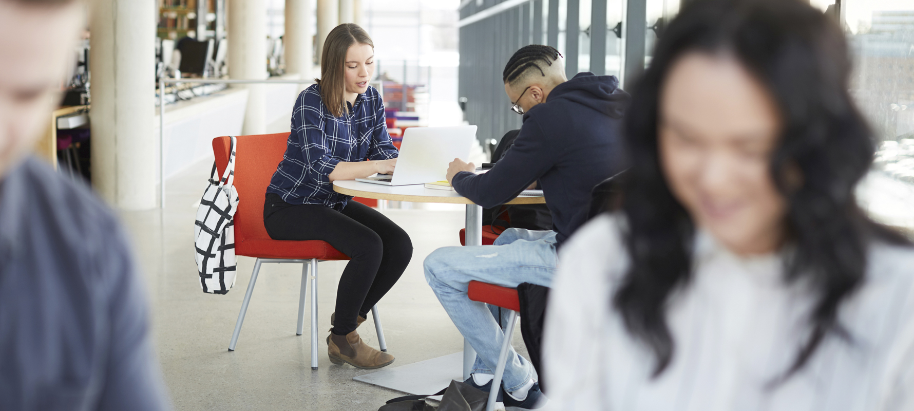Students sit at the table and learn