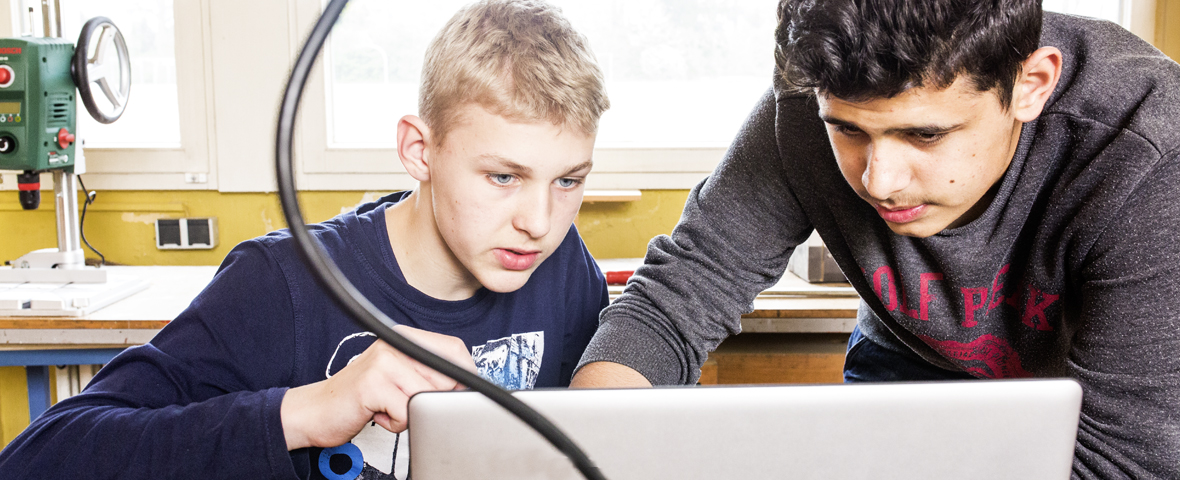 Students working on a laptop